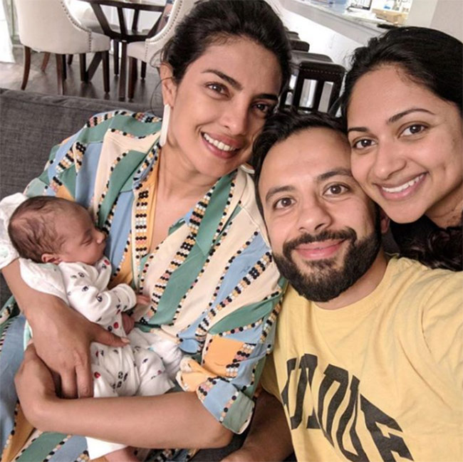 Priyanka chopra with her cousins baby in her arms 201805 1526300956