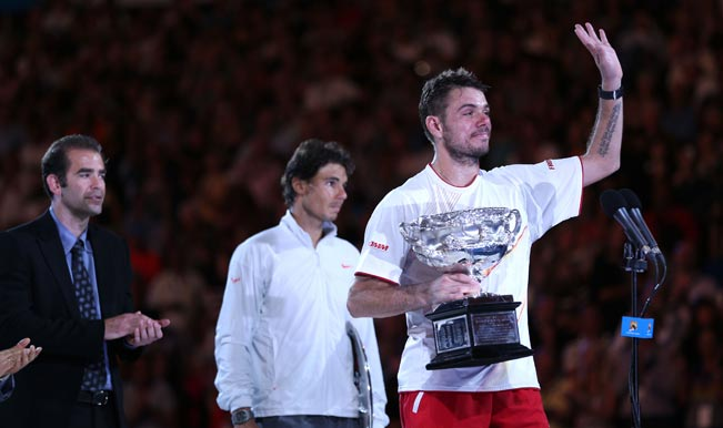 Stanislas-Wawrinka-of-Switzerland-holds-the-Norman-Brookes-Challenge-Cup-after-winni
