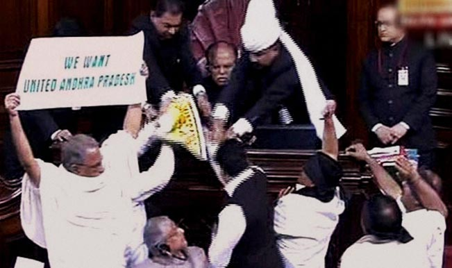 AP-members-protest-for-United-Andhra-Pradesh-in-the-Rajya-Sabha-during-the-extended-winter-session