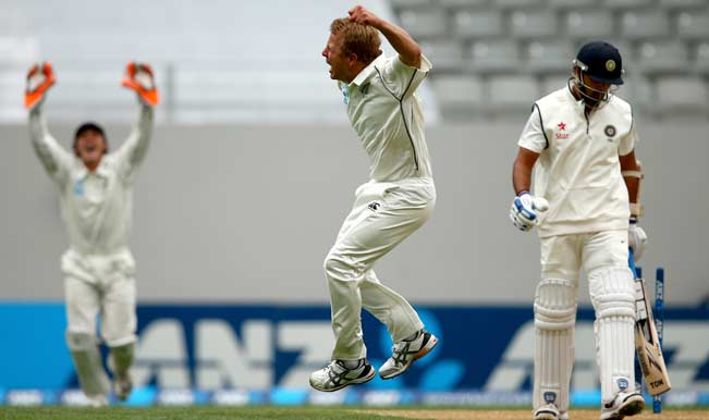 Neil-Wagner-of-New-Zealand-(C)-celebrates-bowling-Murali-Vijay-of-India-(R)-during-day-two-of