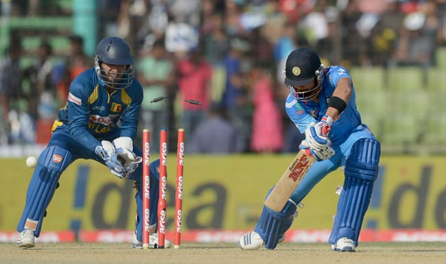 Indian-captain-Virat-Kohli-(R)-is-bowled-by-Sri-Lankan-bowler-Ajantha-Mendis-as-wicketkeeper-Kumar-Sangakkara