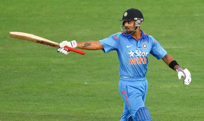 Virat-Kohli-of-India-celebrates-his-half-century-during-the-first-One-Day-International-match-between