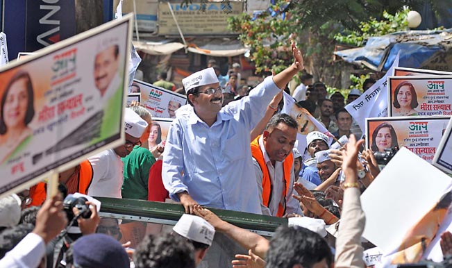 Aam-Aadmi-Party-(AAP)-leader-Arvind-Kejriwal-during-a-road-show-part-of-party`s-election-campaign-for-upcoming-2014