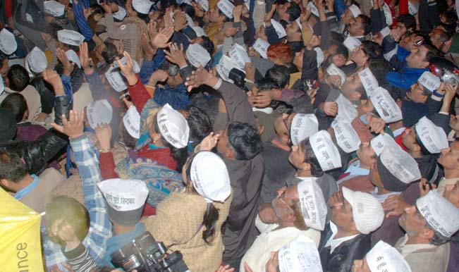Aam-Aadmi-Party-(AAP)-supporters-gather-outside-party`s-office-where-Delhi-Chief-Minister-Arvind-Kejriwal-announced-his-decision-to-resign-from-his-post-in-New-Delhi-on-1