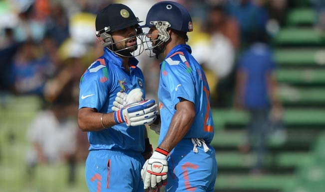 Indian-cricketer-Shikhar-Dhawan-(R)-celebrates-his-half-century-(50-runs)-with-captain-Virat-Kohli-2