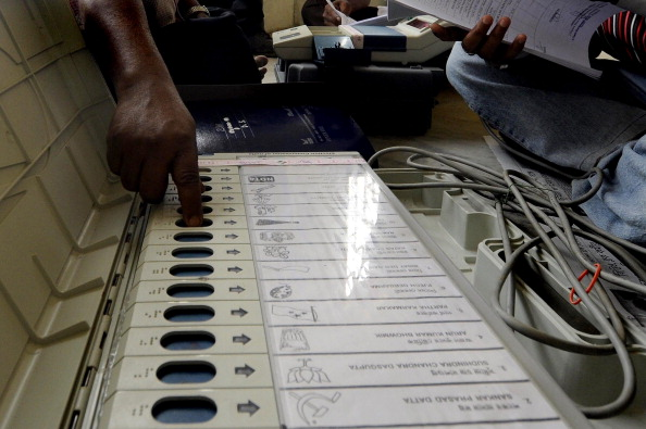 An Indian election official checks an Electronic Voting Machine (EVM) prior to distribution to polling officials at Agartala, the capital of Tripura on April 6, 2014. Photo: Getty Images