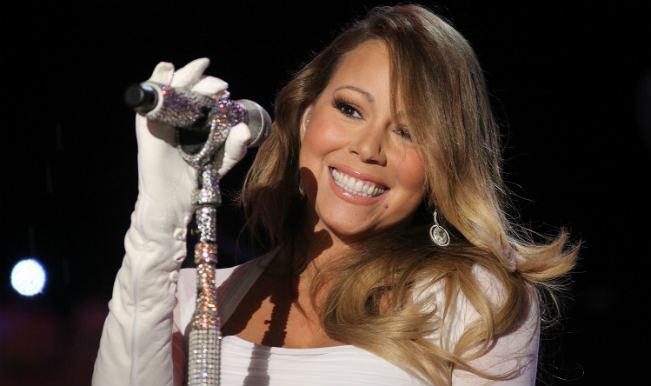 Mariah Carey posts raunchy snaps online