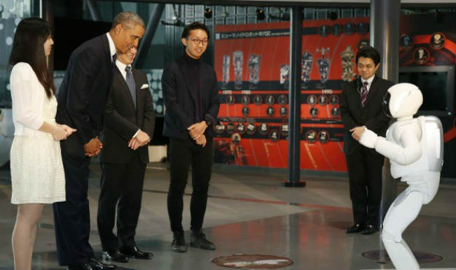 President Barack Obama plays football with a Japanese robot: Watch the video here!