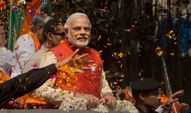 Flower-petals-are-thrown-around-Bharatiya-Janata-Party-(BJP)-leader-Narendra-Modi-as-he-rides-in-an-open-jeep-on-his-wa