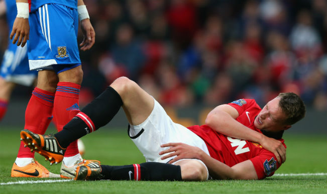 Phil Jones of Manchester United holds his shoulder after sustaining an injury against Hull City (Getty Images)
