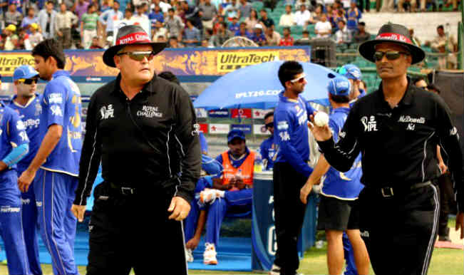 Umpires-Marais-Erasmus-and-K-Srinath-walking-out-on-to-the-field