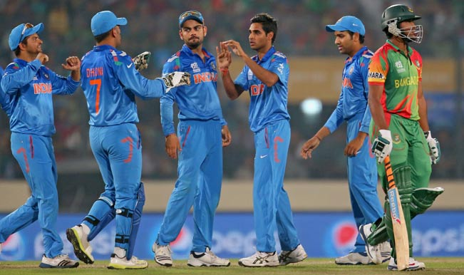 bhuvneshwar-kumar-of-india-is-congratulated-by-his-teammates-after-dismissing-shakib-a-30