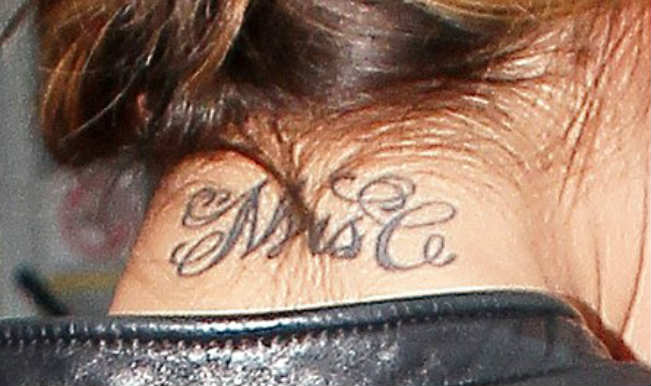 Cheryl cole to get 39 mrs c 39 tattoo removed for Cheryl cole tattoo removal