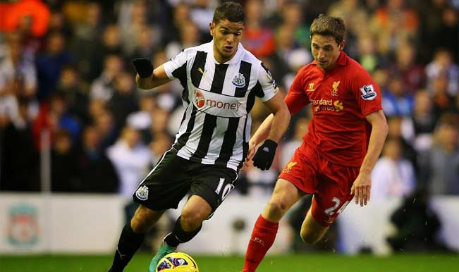 Hatem Ben Arfa of Newcastle tries to shake of Joe Allen's challenge