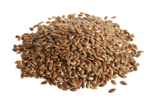 flaxseeds on white background