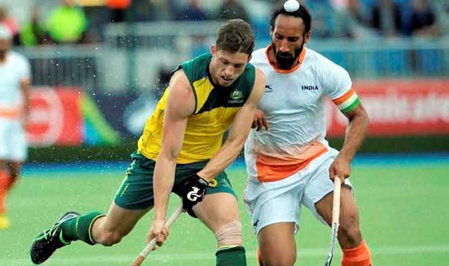 Indian-captain,-Sardar-Singh-tries-to-grab-the-ball-from-Austrailan-player-during-their-hockey-match-at-the-2014-Commonwealth-Games
