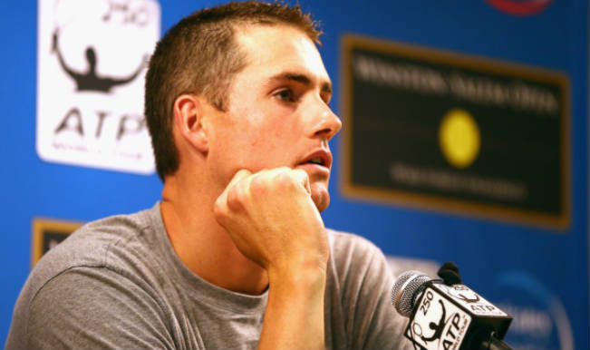 John Isner pulls out of Winston-Salem Open quarters with a left ankle injury
