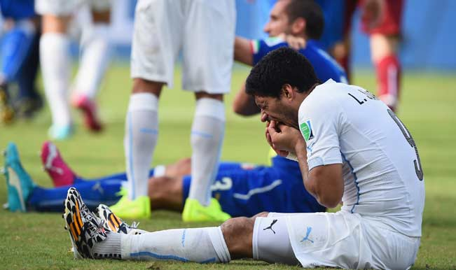 Luis-Suarez-of-Uruguay-and-Giorgio-Chiellini-of-Italy-react-after-a-clash-during-the-2014-FIFA