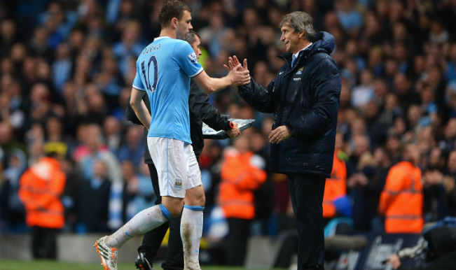 Manchester City manager Manuel Pellegrini admits his squad aren't ready for title defence