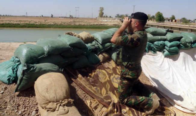 retake Iraq's largest dam from jihadist fighters