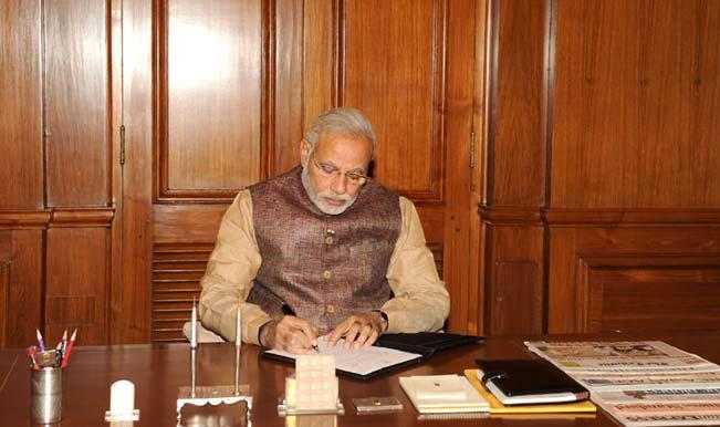 The-Prime-Minister,-Shri-Narendra-Modi-taking-charge-the-office-of-the-Prime-Minister-of-India,-at-South-Block,-in-New-Delhi-on-May-27,-2014.
