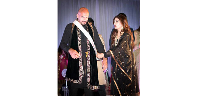 Mr. Bollywood 2014 winner, Waqas Syed gets the sash from Bollywood actress Raveena Tandon. Photo by Harsh M Photography.