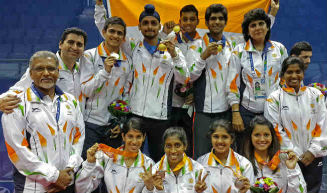 Indian squash contingent with medals123