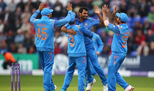 Mohammed-Shami-(2R)-of-India-celebrates-with-Suresh-Raina-(#3)-and-Ajinkya-Rahane--2