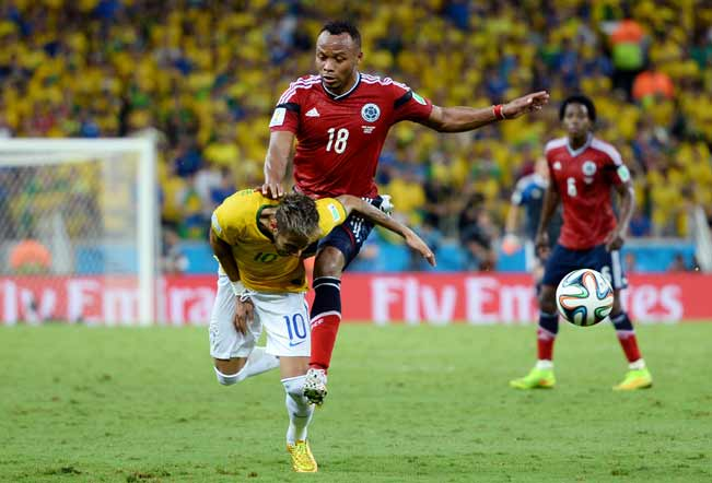 Neymar-of-Brazil-is-challenged-by-Juan-Camilo-Zuniga-of-Colombia