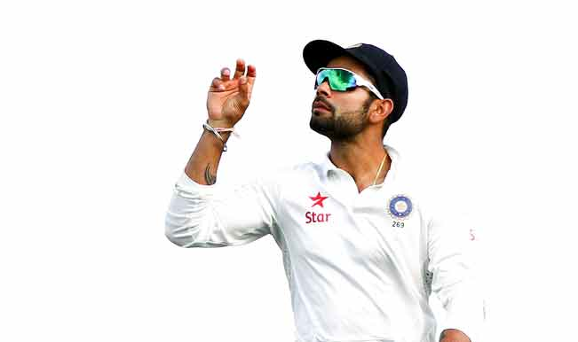 Virat-Kohli-of-India-throws-the-ball-in-the-air-at-the-end-of-an-over-during-day-four-of-the-2