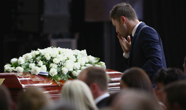 Michael Clarke at funeral