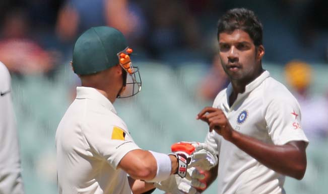 Varun-Aaron-of-India-and-David-Warner-of-Australia-exchange-words