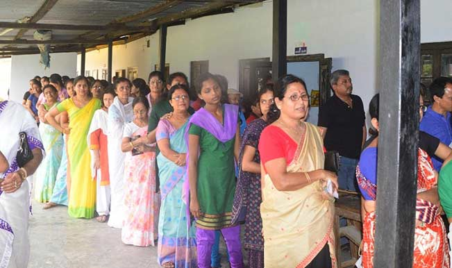 Women-queue-up-to-cast-their-votes-at-a-polling-booth-in-Jorhat-of-Assam