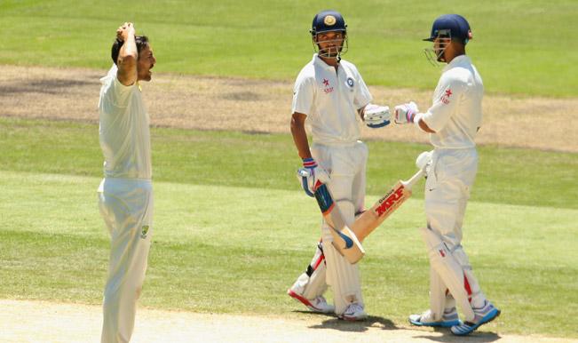 Ajinkya-Rahane-and-Virat-Kohli-of-India-celebrate-after-hitting-Mitchell-Johnson-of-Australia-for-a-boundary