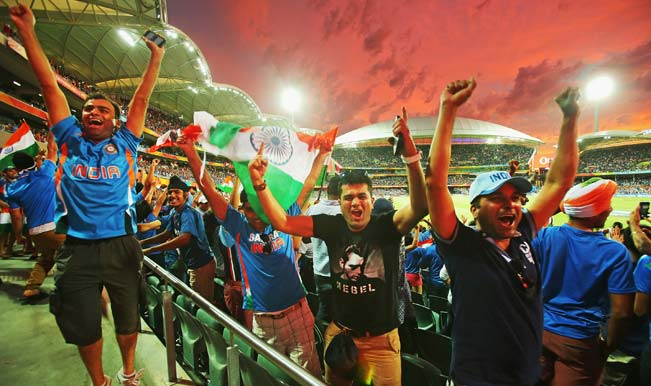 Indian-fans-in-the-crowd-celebrate-as-a-Pakistan-wicket-falls-2