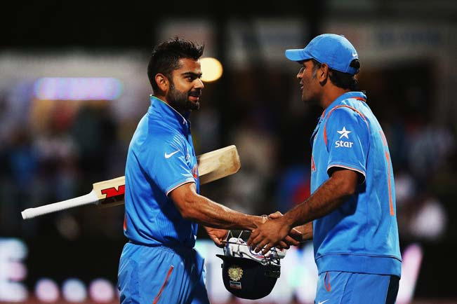 Virat-Kohli-of-India-is-congratulated-by-MS-Dhoni-of-India-after-winning