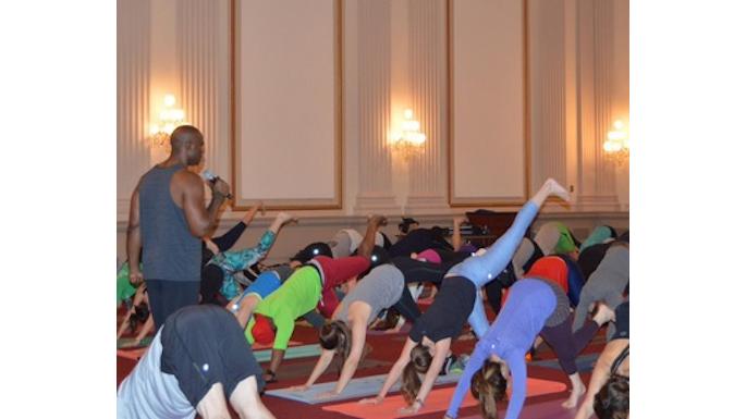 Keith Mitchell leading the yoga event on Capital. (Photo via Congressional Yogi Association)