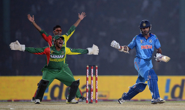 Bangladesh-wicketkeeper-Anamul-Haque-(C)-and-Nasir-Hossain-(L)-unsuccessfully-appeal-for-a-leg-before-wicket-decision-against-Indian-cricketer-Shikhar-Dhawan