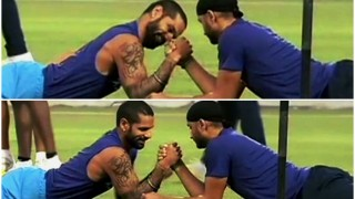 Shikhar Dhawan & Harbhajan Singh's impromptu arm wrestling match is nothing but amazing! (Watch video)