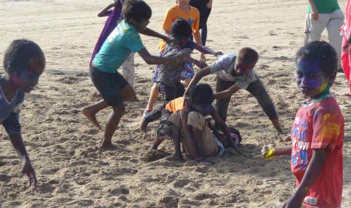 Children celebrating holi at Juhu Beach