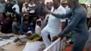 Shocking! BJP lawmaker Vitthal Radadiya repeatedly kicks an old man at a religious function (Watch Video)