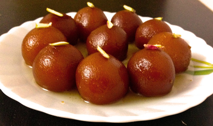 Gulab Jamun Is Basically A Desset Or Sweet Mithai Which Is Made Up Of Freshly Curdled Milk And Further Garnished With Dried Nuts Like Almonds To Enhance