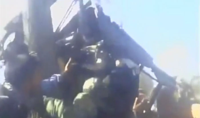 Caught On Camera: Kashmiri youth rescue soldier trapped inside damaged vehicle (Watch Video)