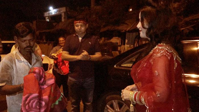 Radhe Maa distributing blankets