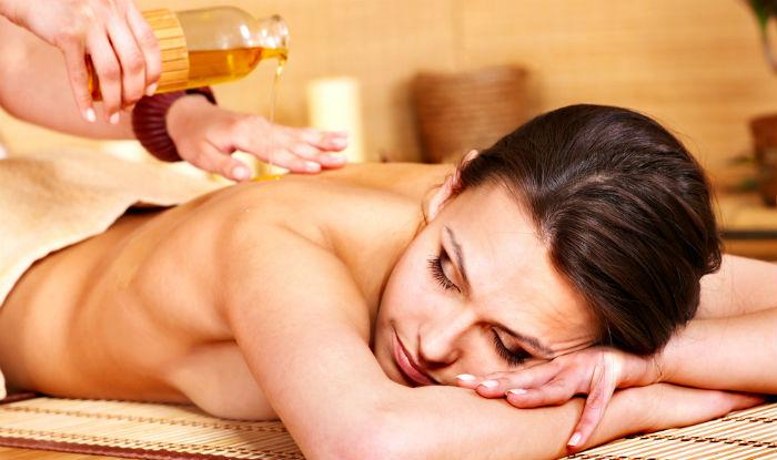Hot oil body massage