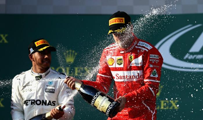 Formula One: Sebastian Vettel pips Lewis Hamilton to win ...