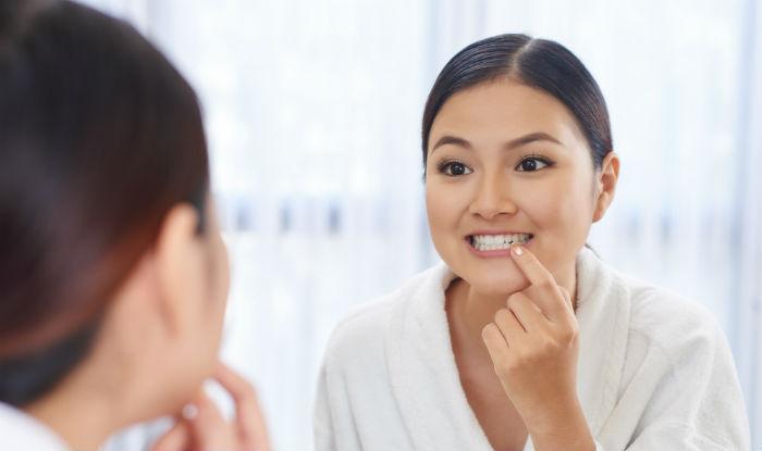 Whiten teeth by using mustard oil
