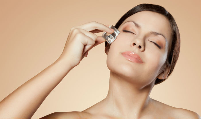 Use a cold compress to get rid of puffy face
