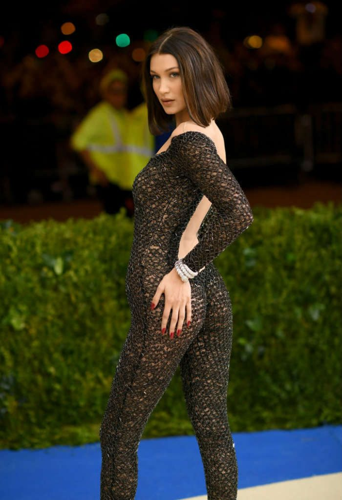 Bella turned up at the event in rather sultry backless glittery catsuit