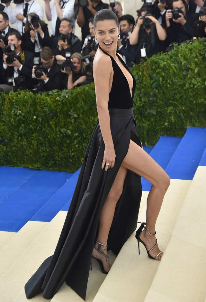 c5c6d800c9b2 Adriana Lima turned plenty of heads in her gorgeous silk black gown that  had a plunging neckline and a slit high up her thighs. She wore this  floor-length ...